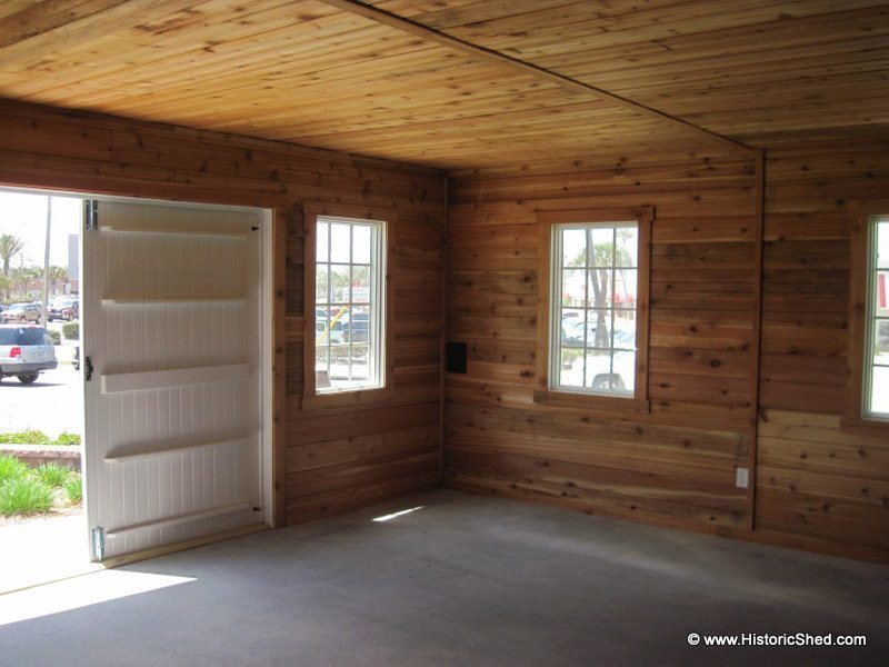 The garage interior was finished with grooved cedar boards.