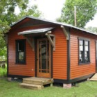 Custom Tiny House on a Foundation by Historic Shed