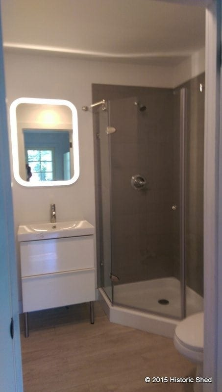 "The 5'-6""x5'-6"" bath has a shower, vanity and toilet, as well as a washer/dryer closet"