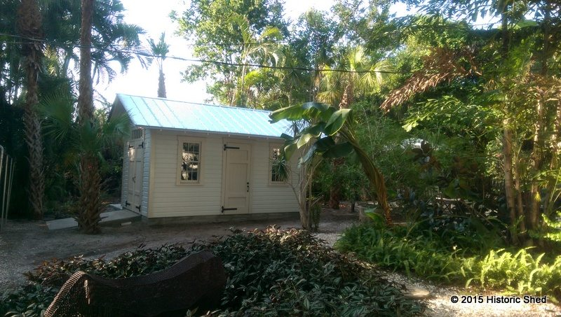 The shed sits nicely in the lushly landscaped yard